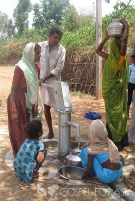 Family gathers water at a Jesus Well