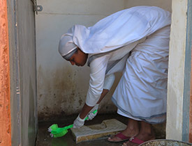 Sisters of Compassion Clean Toilets to Raise Awareness for World Toilet Day